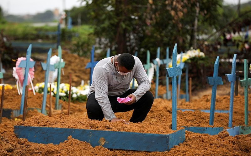 Vitor Soares, 21, reacts during the burial of his grandmother Enedina Correa Soares, 71, who is suspected to have passed away from the coronavirus disease (COVID-19), at the Parque Taruma cemetery in Manaus, Brazil, May 6, 2020. REUTERS/Bruno Kelly