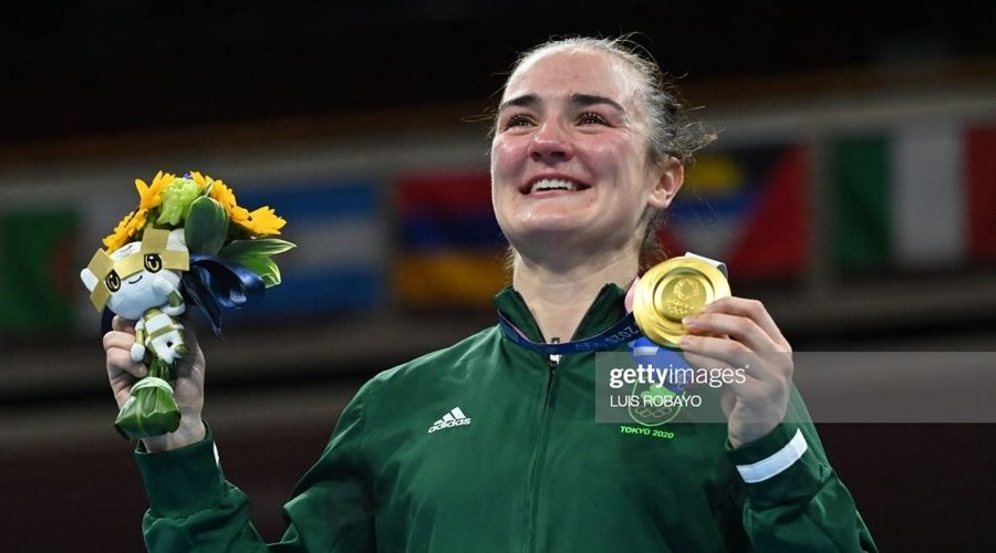 Gold medallist Ireland's Kellie Anne Harrington celebrates on the podium during the victory ceremony for the women's light (57-60kg) boxing final bout during the Tokyo 2020 Olympic Games at the Kokugikan Arena in Tokyo on August 8, 2021. (Photo by Luis ROBAYO / AFP) (Photo by LUIS ROBAYO/AFP via Getty Images)