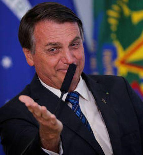 Brazil's President Jair Bolsonaro gestures during a ceremony at the Planalto Palace in Brasilia, Brazil, October 14, 2020. REUTERS/Adriano Machado